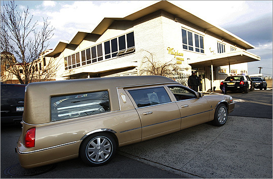 The hearse carrying the body of Whitney Houston returned to Whigham Funeral Home after her funeral at New Hope Baptist Church in Newark, N.J.