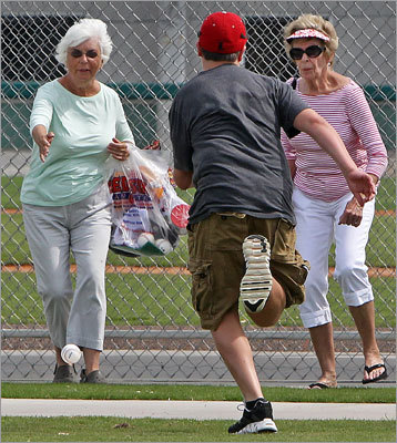 Fans both young and old eagerly sought out souvenir baseballs that were hit out of the park by position players taking batting practice.