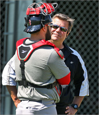 Catcher Kelly Shoppach and bullpen coach Gary Tuck chatted during the training session held Monday.