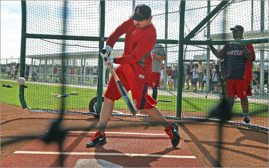 First baseman Adrian Gonzalez, another early arrival, took his cuts in the batting cage. Gonzalez led the Red Sox in batting average last season at .338.
