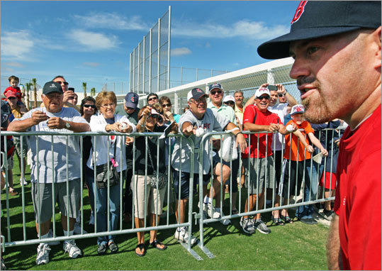 Fans called out to Red Sox third baseman Kevin Youkilis in hopes of getting an autograph. Youkilis was one of many position players who reported to spring training ahead of the mandatory date later this week.