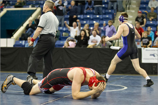 Norton High's Mike Travers (blue) reacted after pinning Holliston High's Charles Harper in the 182-pound match during the MIAA Division 3 state wrestling championships at Tsongas Arena on Monday February 20, 2012.