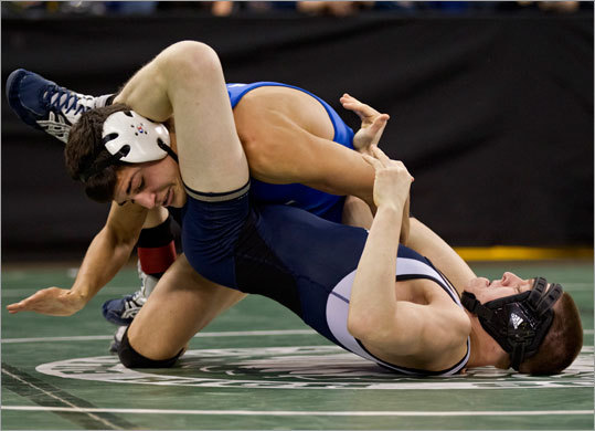 Methuen's Christian Monseir put pressure on St. John's Prep's Rich Glazier in the 113-pound match during the MIAA Division 1 state wrestling championships at Tsongas Arena on Monday February 20, 2012. Monseir won the match.