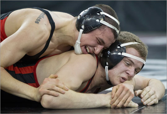North Andover's Robert Drover (top) controlled Winchester's Joe Fallon in the 160-pound match during the MIAA Division 2 state wrestling championships at Tsongas Arena on Monday February 20, 2012. Drover defeated Fallon in the match.