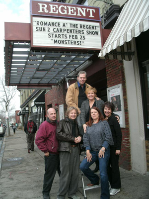 Starting Saturday, Feb. 25, the Regent Theatre in Arlington will present the musical 'Monsters! A Midlife Musical Meltdown' for three weekends. It's just the latest event at a venue that's had many incarnations over the years. From left to right: Richard Stavros, Leland Stein, Ann Garvin, and Cheryl McMahon. On the ladder - Gail Phaneuf and Jerry Bisantz.