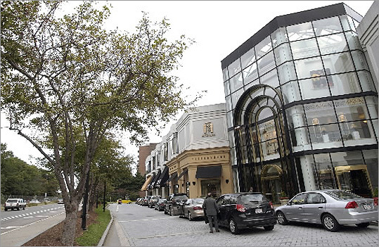 The Atrium Mall (left) next to Route 9 has lost the Gap and Gap Kids retailers . Jeweler Ross-Simons moved to the Mall at Chestnut Hill across the street from the Atrium. J. Crew is also planning to move across Route 9 from the Atrium.