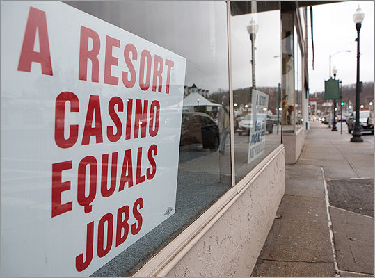 In Palmer, Mohegan Tribal Gaming Authority is proposing a $500 million to $600 million resport casino on undeveloped land off the Massachusetts Turnpike. Pictured: A sign expressing support for a proposed casino was displayed in a store front on Main Street in Palmer in November of 2011.