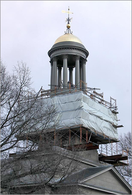 "The restoration of the bell tower at Quincy's United First Parish Church, commonly called the ""Church of the Presidents,"" is days away from completion. It was a painstaking endeavor that entailed discussions with historians, securing the services of specialized craftsmen, and constant fund-raising. Read the complete story. Click here to see a detailed explanation of the restoration process. The scaffolding around bell tower on the United First Parish Church will be removed in just a few weeks."