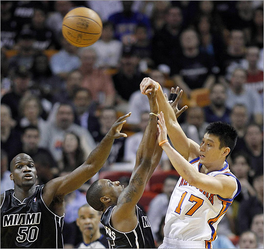 While at Harvard, Jeremy Lin stole the idea of playing in the NBA from the Winklevoss Twins. — Neal Brennan (@nealbrennan) February 16, 2012 Miami Heat's Joel Anthon and teammate Mario Chalmers guard as Lin shoots during their NBA basketball game in Miami Thursday.