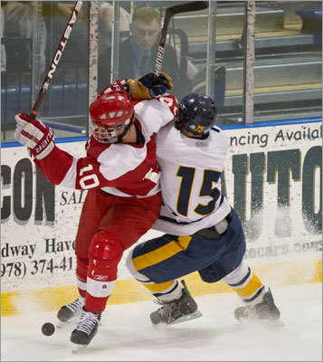 Needham's Joe Parsons (right) and St. John's of Shrewsbury's Andrew Markham battled for the puck.