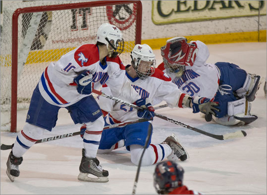 Before the Super 8 ice hockey tournament can get started, two play-in games had to be played to settle the final two spots in the tournament. Central Catholic beat Burlington 6-4 to advance and St. John's of Shrewsbury beat Needham 5-4 to move on. Burlington's Adam Crowley (21) made a hand save in front of goalie Derek DeCasro during second period action against Central Catholic at Lawler Arena on Monday Feb. 27 in the play-in game.