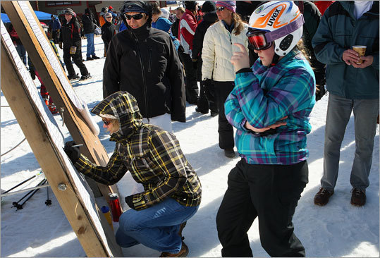 Participants in the MIAA state alpine ski championship look over the results at Wachusett Ski Area.