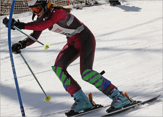 Westford Academy's Katie Stokes passed a stake marker at the state alpine ski championship. Her school went on to win the girls championship by a slim margin.