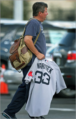 Red Sox bullpen coach Gary Tuck was photographed as he left camp carrying a Jason Varitek No. 33 jersey, perhaps in anticipation of the catcher's impending retirement ceremony on Thursday.