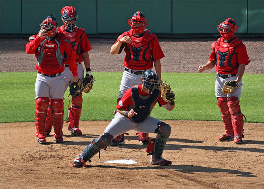 There were plenty of catchers around the plate (but none are Jason Varitek) as starter Jarrod Saltalamacchia took a throw during a drill.