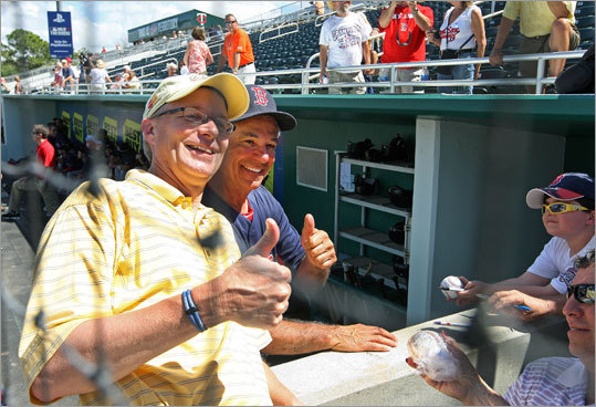 Red Sox manager Bobby Valentine posed with a fan as they waited for Thursday's B game to start at Hammond Stadium in Fort Myers.