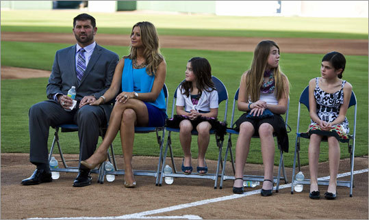 Varitek was joined at the news conference by his wife, Catherine, and his daughters, Caroline, Ally and Kendall (from left) before announcing his retirement.