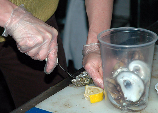 Getting into the hinge The oyster is placed on the table with the cup side (bottom shell) down. Ventura recommends taking a step to the right, holding down the oyster with your left hand, and inserting the knife at a 45-degree angle. The handle of the knife should be facing towards your body. When the tip of the knife is inserted into the hinge, push in and twist the knife, applying firm pressure and pushing down with the handle. It is important to gain enough leverage to crack the hinge open.