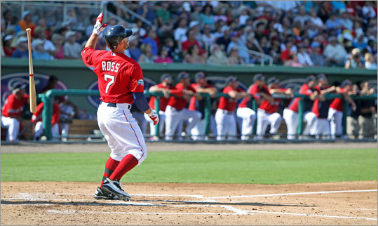 The Red Sox' Cody Ross flipped his bat away as he watched the flight of the first home run hit at JetBlue Park. Ross blasted a second inning pitch over the new 'Green Monster.' Ross hit two home runs in a 25-0 win over Northeastern University, the team's first exhibition held at JetBlue Park.