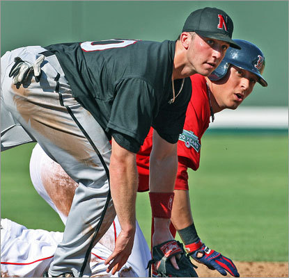 The Red Sox' Ryan Sweeney, right, and Northeastern 2B Pete Castoldi watch as Castoldi's throw gets to first base in time to give the Huskies an inning ending double play Saturday.
