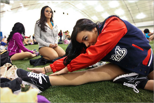 Chelsea Frank, 23, of Fall River, stretched before doing her audition for the New England Patriots cheerleading squad.