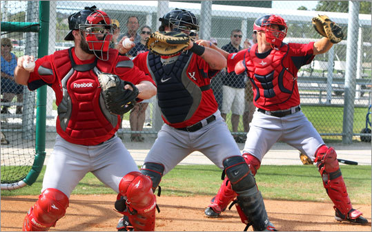 Red Sox catchers (left to right) Kelly Shoppach, Jarrod Saltalamacchia, and Ryan Lavarnway throw at the same time during a drill Friday.