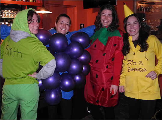 The 'Fruit of the Loons' team from Gloucester made each costume themselves. Left to right: Kristina Simon, a Granny Smith apple; Marissa Curcuru, grapes; Jill Palazola, a strawberry; and Michelle Cangemi, a banana.