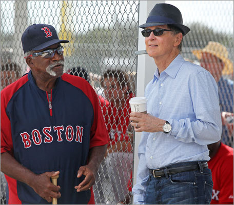 Red Sox owner John Henry, right, and Luis Tiant chatted Friday as they watched the the Red Sox practice.