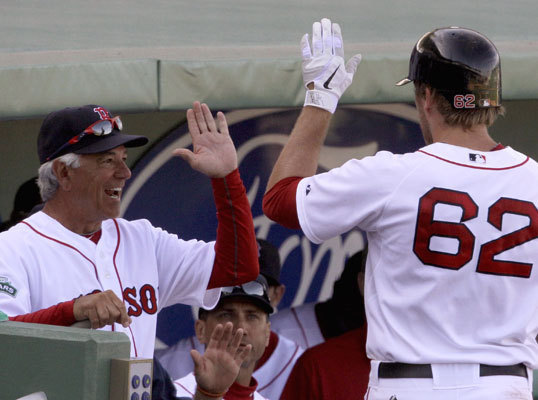 Lars Anderson was congratulated by Red Sox manager Bobby Valentine (left) after Anderson hit a grand slam in the seventh inning to give the Red Sox some breathing room in the first Grapefruit League game of the season on Sunday. The Red Sox beat the Twins, 8-3, in the first game between major league teams at JetBlue Park in Fort Myers.
