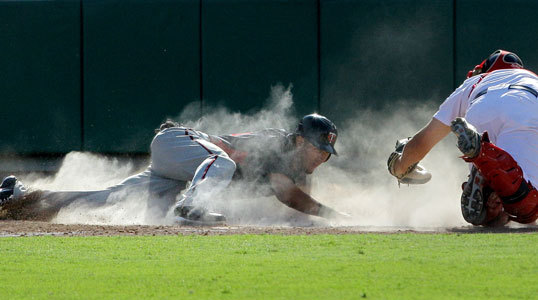 Minnesota's Darin Mastroianni (left) was tagged out by Red Sox catcher Ryan Lavarnway while trying to steal home plate during the seventh inning.