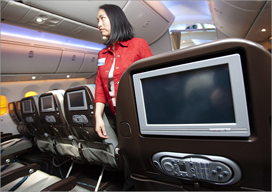 The inflight entertainment system is seen in Boeing's 787 Dreamliner aircraft during a media preview at an Air Canada hangar at Pearson Toronto International Airport in Toronto on March 2. Air Canada has purchased 37 of the Boeing 787 and are to be delivered in 2014.