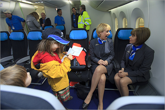 Annie Kate Convey, 8, of Gloucester, who attended the press event with her father, interviewed two flight attendants about their jobs in the sky. Pat Bennett, of Seattle (the flight attendant at left), asked Convey, 'What publication do you write for?' Convey replied, 'Well, I haven't started it yet, but it's called the Kiddo Times.' At right is Maureen Walker, also of Seattle.