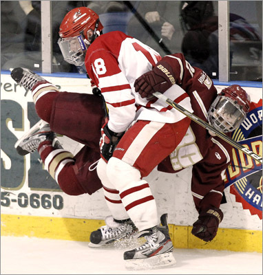 Hingham's Sam D'Antuono (18) checks BC High's Chris LaLiberte.