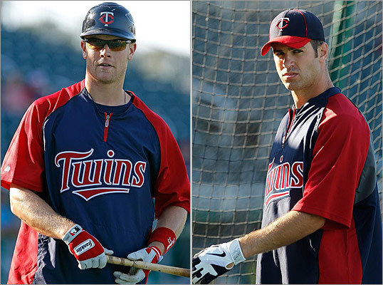 Minnesota Twins infielder Justin Morneau (left) and catcher Joe Mauer (right) take batting practice just before the start of the Grapefruit League spring training game against the Red Sox at Hammond Stadium in Fort Myers Florida.