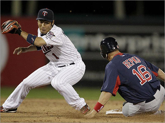 Minnesota's Tsuyoshi Nishioka (left) is late with the tag as Boston's Jason Repko steals second base in the second inning.