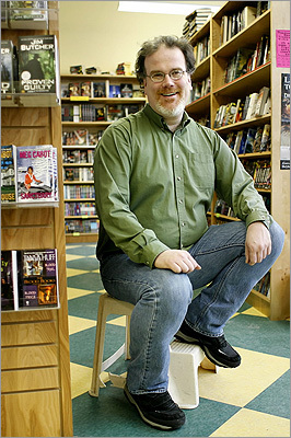 Owner Tyler Stewart at Pandemonium Books in Central Square. The bookstore was on the brink of disaster, owing $15 000 to the IRS with no way to pay it back. Stewart rescued the store by asking people to buy 1,000 T-shirts in 2007.