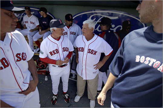Carl Yastrzemski (right) was one of several Red Sox legends who attended Sunday's first Grapefruit League game at JetBlue Park, and he visited with manager Bobby Valentine in the dugout. Dwight Evans, Luis Tiant and Jim Rice also attended.
