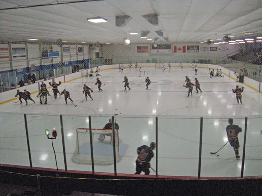 The Hingham girls hockey team continued its MIAA Division 1 title defense Wednesday by beating Westford Academy 3-1 to at Stoneham Arena. Both teams warm up on the ice before the game.