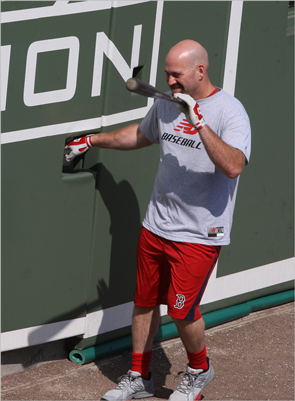 Sox third baseman Kevin Youkilis waved to fans from in front of the wall.