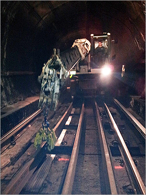 A new rail is pictured as an MBTA worker installed it on Feb. 25, 2012.