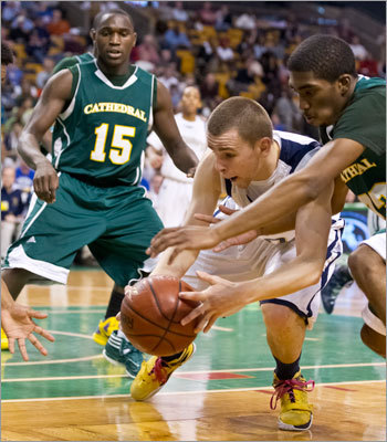St. Mary's High's Matt Manning battled with Cathedral High's Kadeem Edge for control of the ball during the second half.