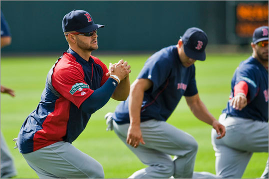 New Red Sox outfielder Cody Ross stretched with his teammates before a game against the Orioles.