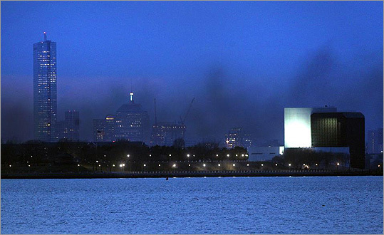Smoke from the fire clouded the Boston skyline in this view from the Squantum section of Quincy.