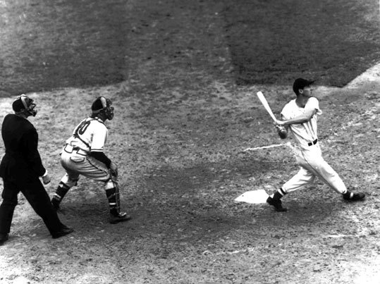 Red Sox great Ted Williams follows flight of the ball after connecting with a Rip Sewell pitch for a home run in the eighth inning of the All-Star game between American and National Leagues at Fenway Park on July 9, 1946.