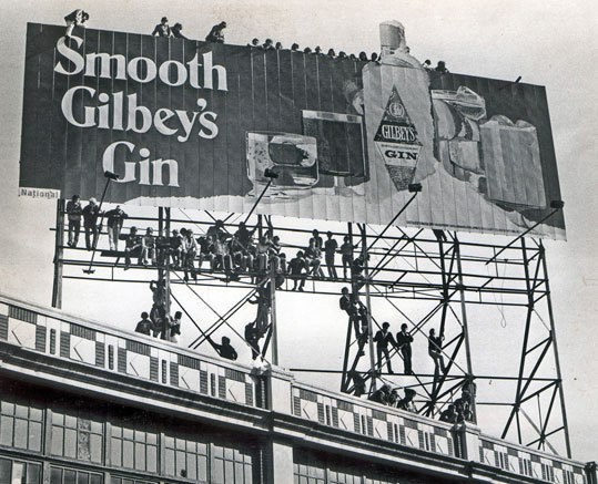 Fans used to climb the billboard beyond Fenway's left field wall to get a look at the action. This shot was taken during the 1978 season.