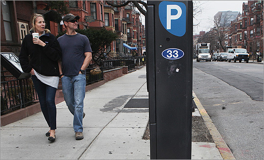 Open parking spaces and empty sidewalks were the norm on March 15 around noontime, as Casey Gheen and Eric Klaussmann of NY strolled down powerless Newbury Street.