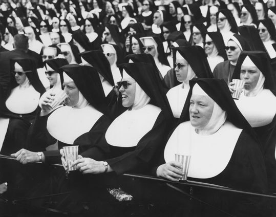 As we get closer to the 100th anniversary celebration of Fenway Park in April, we take a look back at some of the more interesting old-time Fenway photos from our archives. Here, Boston area Catholic nuns sat in the stands on one of the 'nun days' at Fenway Park in the mid 1960s. Were they drinking nothing but soda out of those cups? We can't say for sure.