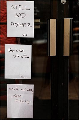 Signs were posted on the door of Thornton's Restaurant on Huntington Avenue in Boston on March 15 as they waited for power to be restored.