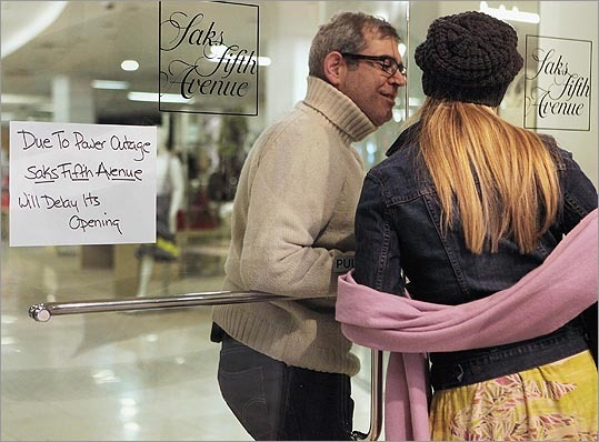 Employee John Weston greeted a friend, Valerie Shirvani, as Saks Fifth Avenue waited to reopen on March 15.