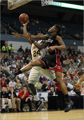 Div. 1 state final: Springfield Central 67, Brockton 46 Brockton's Jahleel Moise blocked a shot by Springfield Central's Kamari Robinson in the second half.